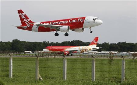 An AirAsia Airbus A320 passenger jet lands at Sukarno-Hatta airport in Tangerang on the outskirts of Jakarta in this January 30, 2013 picture. REUTERS/Enny Nuraheni/Files