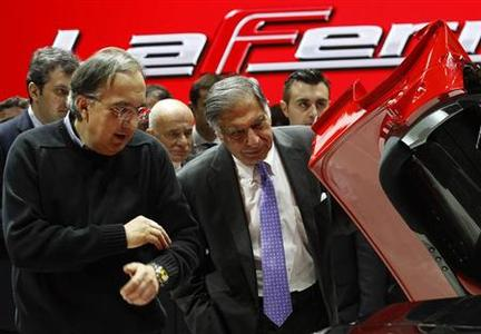 Fiat CEO Sergio Marchionne (L) inspects with Tata Motors' Chairman Ratan Tata the new LaFerrari hybrid car on the Ferrari stand during the first media day of the 83rd Geneva Car Show at the Palexpo Arena in Geneva March 5, 2013. The Geneva Motor Show will take place from March 7 to 17, 2013. REUTERS/Denis Balibouse (