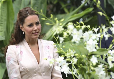 Britain's Catherine, the Duchess of Cambridge, looks at the Dendrobium Memoria Princess Diana orchids as she tours the National Orchid Garden in the Singapore Botanic Gardens September 11, 2012. REUTERS/Stephen Morrison/Pool