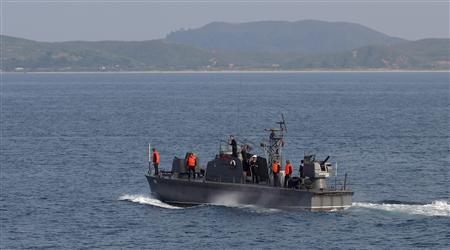 A North Korean navy patrol boat is seen near Mount Kumgang resort in Kumgang September 1, 2011. REUTERS/Carlos Barria