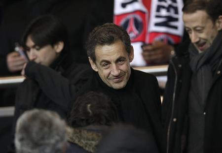 Former French President Nicolas Sarkozy attends the French Ligue 1 soccer match where Paris Saint-Germain plays Olympic Marseille at the Parc des Princes stadium in Paris February 24, 2013. REUTERS/Gonzalo Fuentes