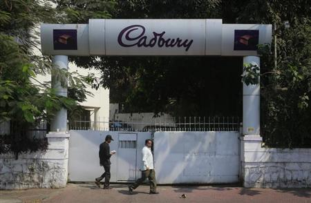 People walk on a pathway in front of the Cadbury India headquarters in Mumbai March 6, 2013. REUTERS/Danish Siddiqui