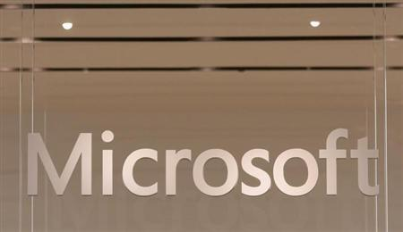 The Microsoft logo hangs from a window during the grand opening of Microsoft's first retail store in Scottsdale, Arizona October 22, 2009. REUTERS/Joshua Lott