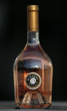 A bottle of ''Miraval, Cote de Provence'' rose wine is displayed in Paris, March 4, 2013. REUTERS/Christian Hartmann
