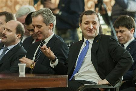 Moldova's Prime Minister Vlad Filat (2nd R) and members of his government react during a session of the Parliament in Chisinau, March 5, 2013. REUTERS/Viktor Dimitrov