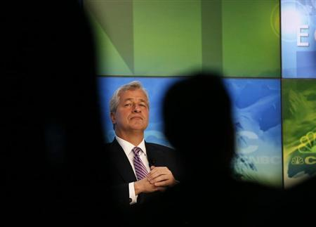JP Morgan Chairman and Chief Executive Jamie Dimon is seen in between the audience as he attends a session during the annual World Economic Forum (WEF) meeting in Davos, January 23, 2013. REUTERS/Pascal Lauener