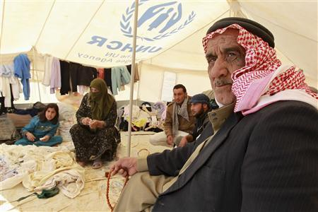 Syrian refugees sit in a second hand clothes shop at Al Zaatri refugee camp in the Jordanian city of Mafraq, near the border with Syria, March 6, 2013. UNHCR said the number of Syrians quitting their country has increased dramatically since the beginning of the year with more than 400,000 - nearly half the total - leaving since January 1. Most have fled to Lebanon, Jordan, Turkey, Iraq and Egypt and some to North Africa and Europe, arriving traumatised, without possessions and having lost relatives, it said. REUTERS/Muhammad Hamed