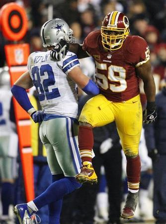 Washington Redskins linebacker London Fletcher (59) celebrates after defending a pass away from Dallas Cowboys tight end Jason Witten (82) during the second half of their NFL football game in Landover, Maryland, December 30, 2012. REUTERS/Jonathan Ernst