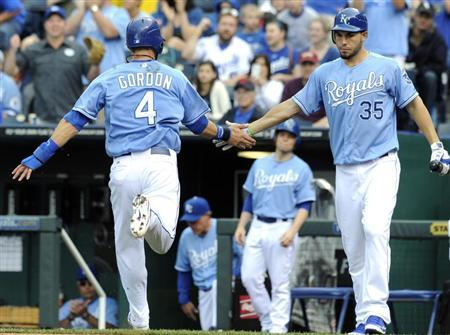 Kansas City Royals Alex Gordon is congratulated by Eric Hosmer (R) after scoring on a Billy Butler double in the first inning against the New York Yankees during their MLB American League baseball game in Kansas City, Missouri May 6, 2012. REUTERS/Dave Kaup