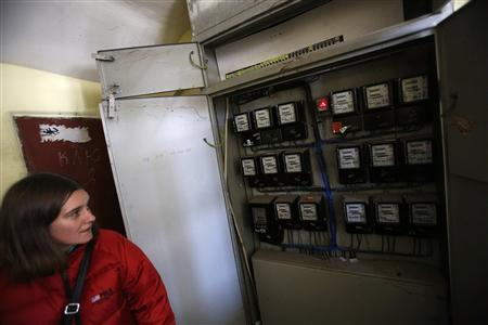 Bulgarian Lora Todorova shows the electricity meters at her apartment block in a subrub of Sofia February 28, 2013. In a run down area on the edge of Bulgaria's capital, some residents are risking their neighbours' ire - and even their lives - to steal electricity. Picture taken February 28, 2013. To match Insight BULGARIA-GOVERNMENT/ REUTERS/Stoyan Nenov (BULGARIA - Tags: CRIME LAW POLITICS ENERGY)