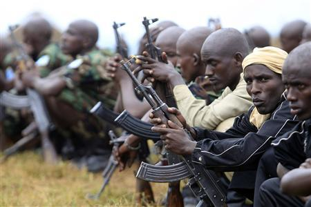 Somali government soldiers trained by the European Union Training Mission (EUTM) team are pictured with their weapons as they wait for their passing out ceremony at Bihanga army training camp, 368 km (230 miles) west of Uganda's capital Kampala, February 1, 2013. REUTERS/James Akena