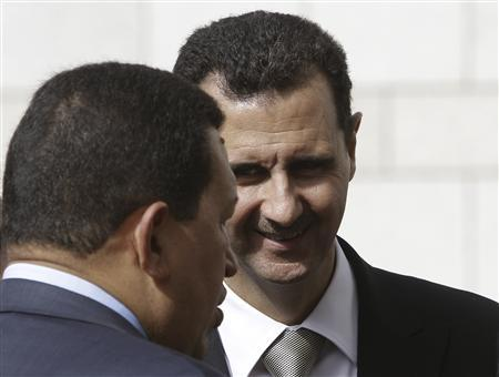Syria's President Bashar al-Assad (R) speaks with Venezuela's President Hugo Chavez in Damascus October 21, 2010. REUTERS/Khaled al-Hariri