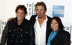 "Neal Schon (L) and Jonathan Cain of the band Journey arrive with director Ramona Diaz for the premiere of ""Don't Stop Believin': Everyman's Journey"" during the 2012 Tribeca Film Festival in New York, April 19, 2012. REUTERS/Lucas Jackson"