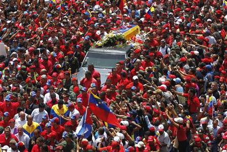 The coffin of Venezuela's late President Hugo Chavez is driven through the streets of Caracas after leaving the military hospital where he died of cancer, in Caracas March 6, 2013. REUTERS/Jorge Dan Lopez
