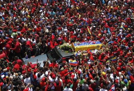 The coffin of Venezuela's late President Hugo Chavez is driven through the streets of Caracas after leaving the military hospital where he died of cancer in Caracas, March 6, 2013. REUTERS/Jorge Dan Lopez