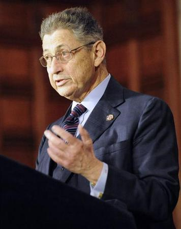 Assembly Speaker Sheldon Silver applauds New York Governor Andrew Cuomo after the New York Secure Ammunition and Firearms Enforcement Act was signed in Albany, New York January 15, 2013. REUTERS/Hans Pennink