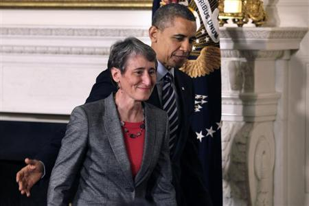 President Barack Obama leaves with Sally Jewell, CEO of Recreational Equipment Inc., his nominee for Interior Secretary, at the White House in Washington February 6, 2013. REUTERS/Yuri Gripas