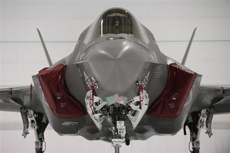 A U.S. Marine F-35B Joint Strike Fighter Jet sits in a hangar after the roll-out Ceremony at Eglin Air Force Base in Florida February 24, 2012. REUTERS/Michael Spooneybarger