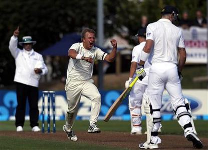 New Zealand's Neil Wagner (C) celebrates after dismissing England's Kevin Pietersen (R) for a duck during the second day of the first test at the University Oval in Dunedin March 7, 2013. REUTERS/David Gray