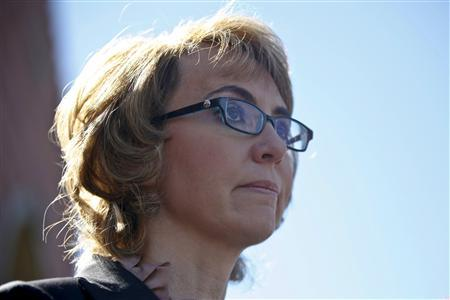 Former congresswoman Gabrielle Giffords addresses a news conference for victims of the January 8, 2011 Tucson shooting, at the Safeway grocery store parking lot where Giffords was shot during the incident in Tucson March 6, 2013. REUTERS/Samantha Sais