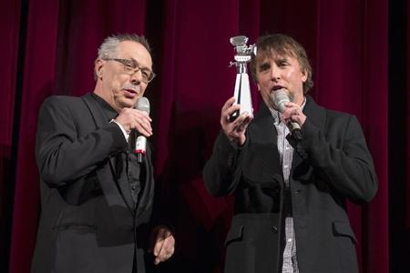 Director Richard Linklater (R) holds a special Berlinale Camera award that was presented by festival director Dieter Kosslick after the screening of his movie ''Before Midnight'' at the 63rd Berlinale International Film Festival in Berlin February 11, 2013. REUTERS/Thomas Peter
