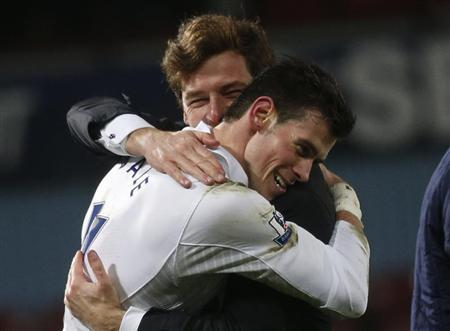 Tottenham Hotspur's Gareth Bale embraces manager Andre Villas-Boas after beating West Ham United in their Premier League match at Upton Park stadium in east London February 25, 2013. REUTERS/Eddie Keogh