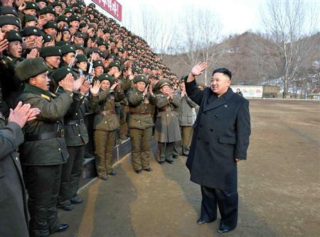 North Korean leader Kim Jong-un (R) waves during an inspection of the Korean People's Army Unit 323 honoured with the title of O Jung-hup-led 7th Regiment, in this undated recent picture released by the North's official KCNA news agency in Pyongyang February 21, 2013. REUTERS/KCNA