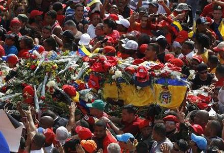 The coffin of late Venezuelan leader Hugo Chavez is driven through the streets of Caracas, after leaving the military hospital where he died of cancer, March 6, 2013. REUTERS/Mariana Bazo