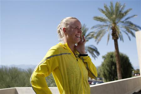 Caroline Wozniacki of Denmark smiles as she is interviewed during a media availability at the BNP Paribas Open WTA tennis tournament in Indian Wells, California, March 6, 2013. REUTERS/Danny Moloshok