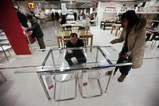 Customers check a table at an IKEA store in Beijing, February 22, 2013. REUTERS/Petar Kujundzic