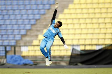 Bangladesh's captain Mushfiqur Rahim jumps as he tries to catch a ball during a practice session ahead of their Twenty20 World Cup match against Pakistan in Pallekele September 24, 2012. REUTERS/Dinuka Liyanawatte /Files