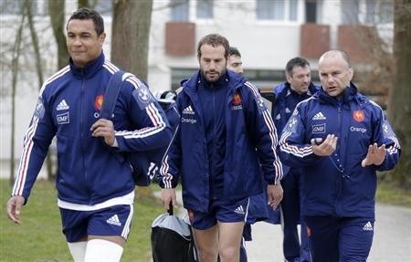 France's rugby team players Thierry Dusautoir (L), Frederic Michalak (C) and coach assistant Yannick Bru arrive for a training session at the Rugby Union National Centre in Marcoussis, south of Paris, March 5, 2013. REUTERS/Jacky Naegelen