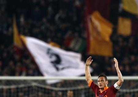 AS Roma's Francesco Totti celebrates after scoring against Juventus during their Italian Serie A soccer match at the Olympic stadium in Rome February 16, 2013. REUTERS/Alessandro Bianchi