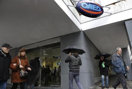 People walk outside an unemployment bureau in Athens February 14, 2013. REUTERS/John Kolesidis