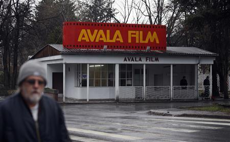 A man passes ''Avala Film'' in Belgrade February 26, 2013. On a forested hill above the Serbian capital, stray dogs nose through plywood film sets, the remnants of what was once one of the world's most prolific movie studios. REUTERS/Marko Djurica