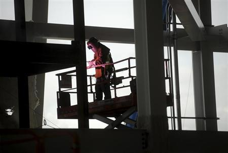 A worker welds a support at Santa Clara Stadium, the future home of the NFL's San Francisco 49'ers, in Santa Clara, California March 6, 2013. The stadium is scheduled to open in time for the 2014 NFL season. REUTERS/Noah Berger