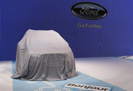A car is covered on the Ford stand ahead of the 83rd Geneva Car Show at the Palexpo Arena in Geneva March 4, 2013. REUTERS/Denis Balibouse
