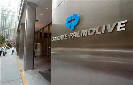 People pass the entrance of Colgate-Palmolive World headquaters in New York City, August 31, 2003.
