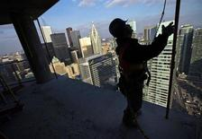 "A construction worker works on the ""ICE Condominiums"" development site by Cadillac Fairview and Lanterra Developments in Toronto December 14, 2012. REUTERS/Mark Blinch"