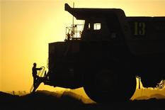 A driver climbs from a haul truck at Rio Tinto's Bengalla coal mine in the Hunter Valley north of Sydney in this October 3, 2006 handout photograph. REUTERS/Rio Tinto/Handout