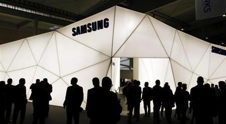 Visitors are seen in front of the Samsung stand during the Mobile World Congress at Barcelona, February 27, 2013. REUTERS/Albert Gea