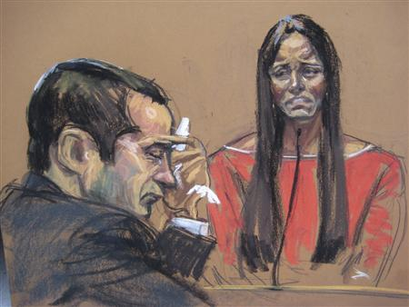 Former New York City police officer Gilberto Valle (L), dubbed by local media as the ''Cannibal Cop'', listens as his wife Kathleen Mangan testifies in this courtroom sketch on the first day of his trial in New York February 25, 2013. REUTERS/Jane Rosenburg