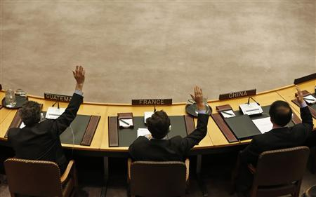 Members of the United Nations Security Council vote to tighten sanctions on North Korea at the United Nations Headquarters in New York, March 7, 2013. In response to North Korea's third nuclear test, the U.N. Security Council voted on Thursday to tighten financial restrictions on Pyongyang and crack down on its attempts to ship and receive banned cargo in breach of U.N. sanctions. REUTERS/Brendan McDermid