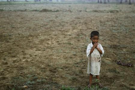 A boy, displaced by the recent violence in Pauktaw stands in the field near Owntaw refugee camp for Muslims outside Sittwe early November 1, 2012. REUTERS/Soe Zeya Tun