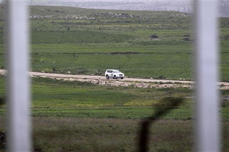 A United Nations vehicle drives near the Syrian village of Al Jamla, close to the ceasefire line between Israel and Syria, as seen from the Israeli occupied Golan Heights March 5, 2013. Syrian rebels have seized a convoy of U.N. peacekeepers near the Golan Heights and say they will hold them captive until President Bashar al-Assad's forces pull back from a rebel-held village which has seen heavy recent fighting. Picture taken March 5, 2013. REUTERS/Baz Ratner