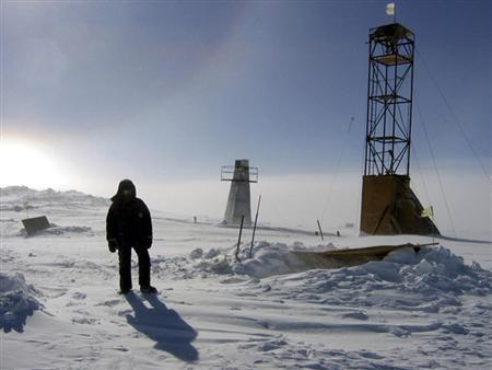 A man stands near drilling apparatus at the Vostock research camp in Antarctica in this January 13, 2006 handout photograph. REUTERS/Alexey Ekaikin/Handout