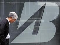 A man walks past a logo of Bridgestone Corp at the company's headquarters in Tokyo February 18, 2011. REUTERS/Toru Hanai