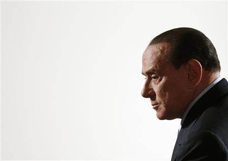 Former Italian prime minister Silvio Berlusconi arrives for a political rally in downtown Rome in this January 25, 2013 file photograph. REUTERS/Max Rossi/Files