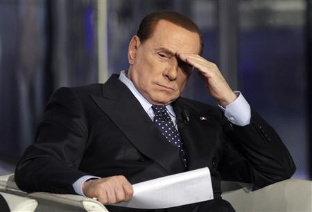 Italy's former Prime Minister Silvio Berlusconi gestures on a television show in Rome in this February 20, 2013 file photo. REUTERS/Remo Casilli/Files