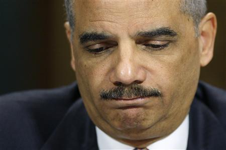 U.S. Attorney General Eric Holder pauses during testimony before the Senate Judiciary Committee on Capitol Hill in Washington, March 6, 2013. REUTERS/Jonathan Ernst